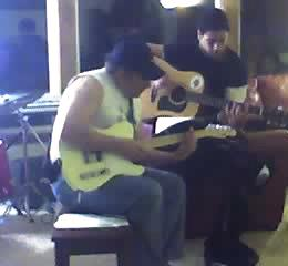 Dr. Morse and his son Brett play guitar together